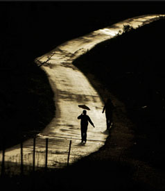 A Palestinian walks along a deserted road in the West Bank city of Ramallah. (Photo: Muhammed Muheisen / AP)