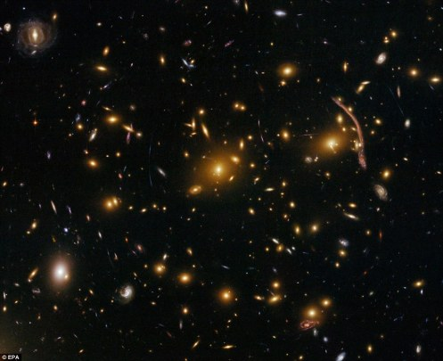 Gravitational Lensing in Galaxy Cluster Abell 370: The Hubble Space Telescope's ACS has peered nearly 5 billion light-years away to reveal intricate details in this galaxy cluster