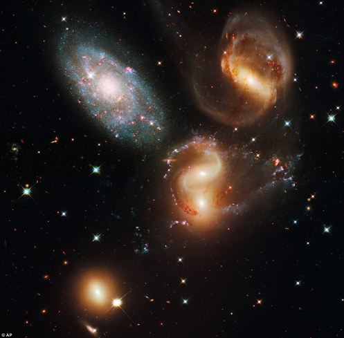 Stephan's Quintet: A clash among members of a famous galaxy quintet reveals an assortment of stars across a wide colour range, from young, blue stars to aging, red stars. Stephan's Quintet, also known as Hickson Compact=